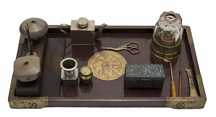 An early 20th century set of Chinese opium tools