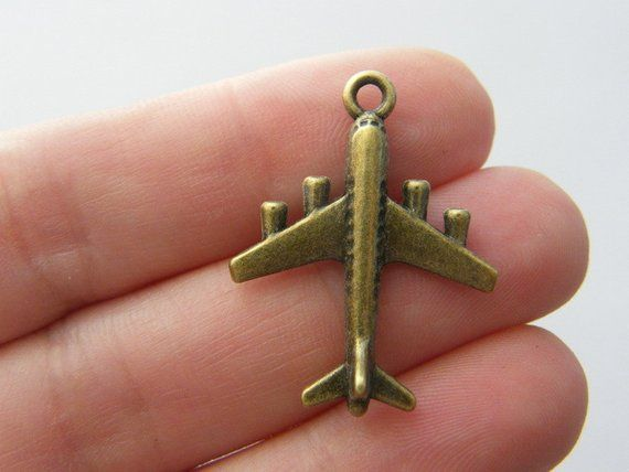 6 Aeroplane charms antique bronze tone BC137