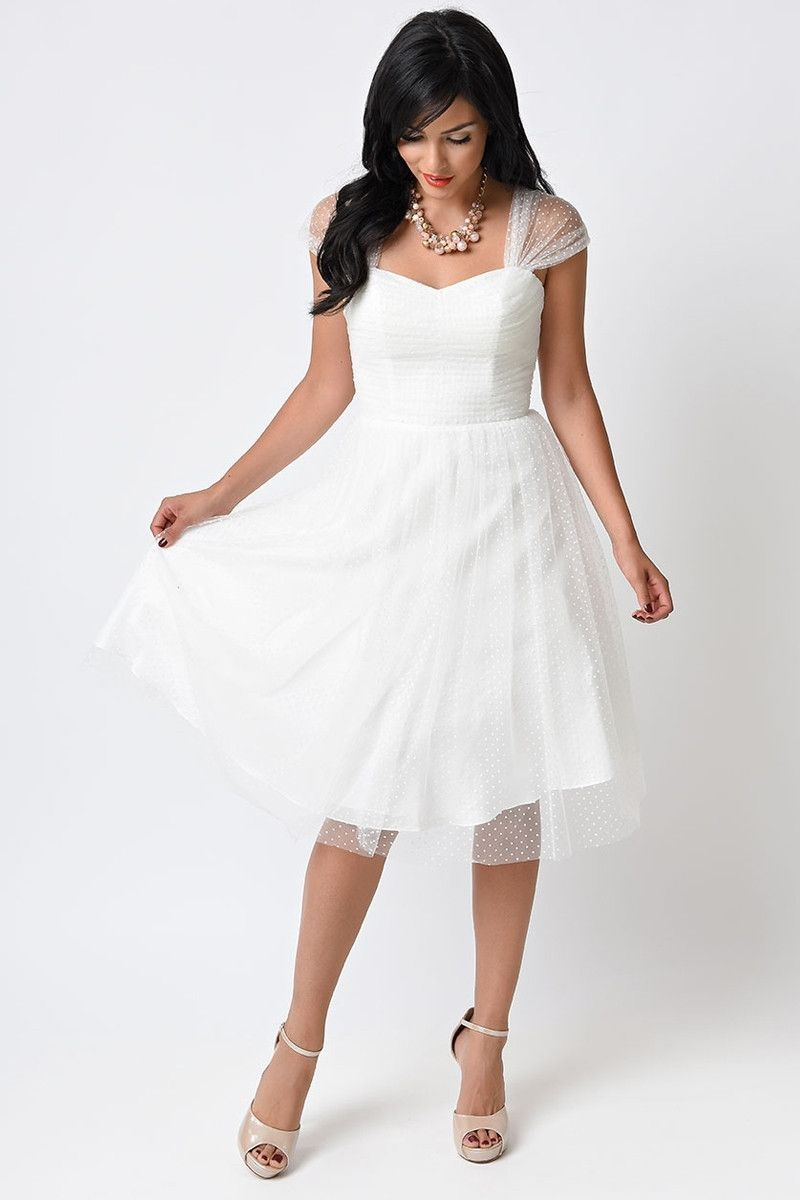 Retro vintage cocktail dress with sheer cap sleeves in pastel colors