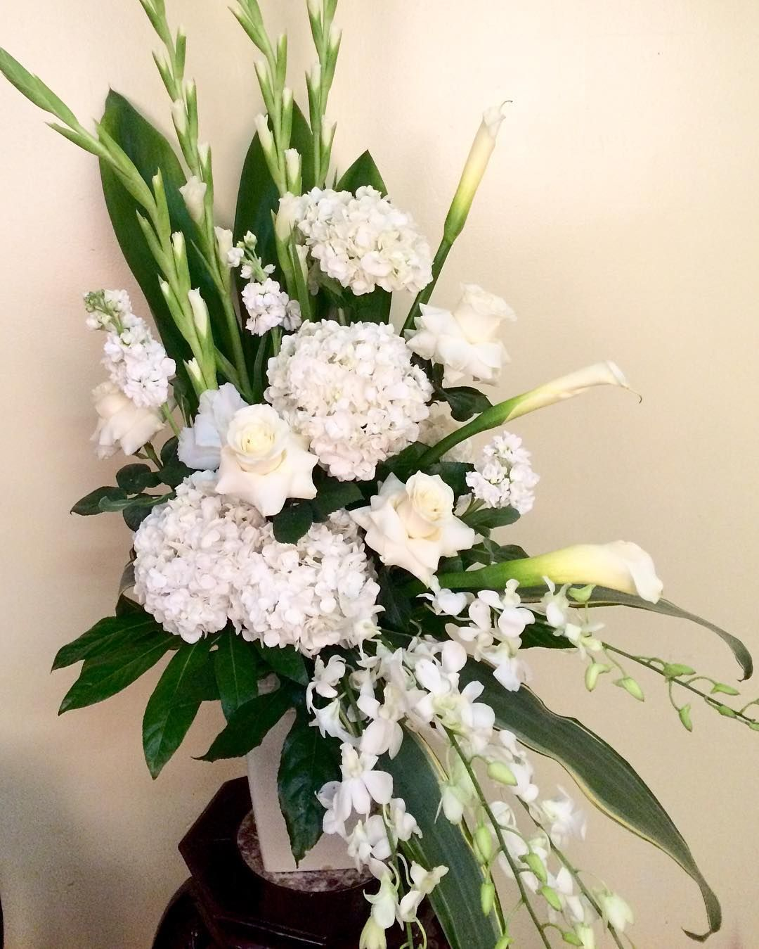 All White Perfection Orchids Roses And Hydrangea Bestfloristinhouston Bestflowersinhouston Houstonflorist Houstonflowers Flowersbynino Whiteflowers We