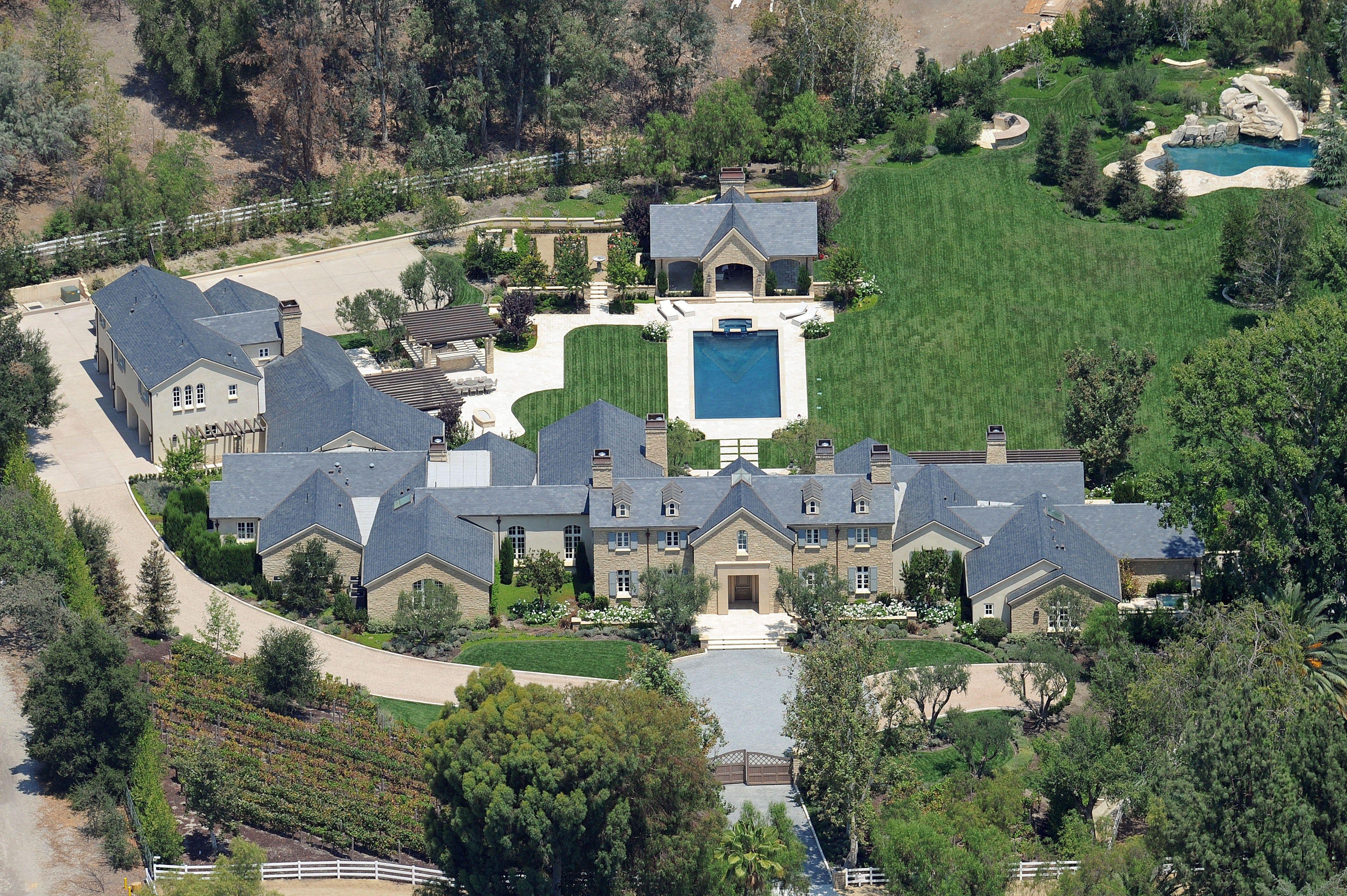 Kim Kardashian And Kanye West Move Into 20 Million Mansion In Hidden Hills Leave Kris Jenner S House Kardashians House Mansions Kim Kardashians House