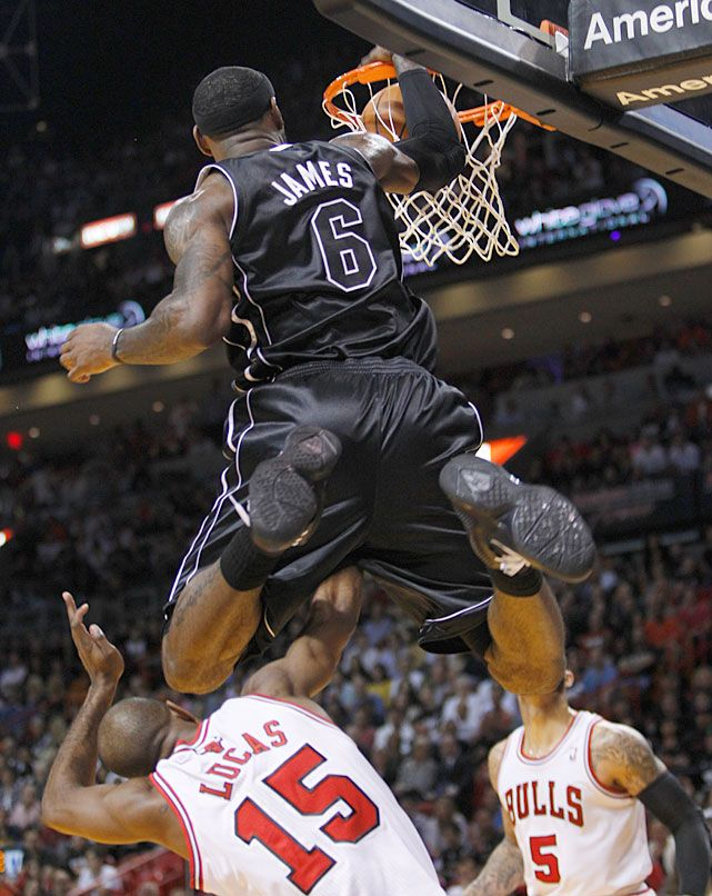0b9c37c86ec Heat forward LeBron James hurdles and dunks over Bulls guard John Lucas  during Sunday s Miami-Chicago game. The Bulls made it a close game at the  end