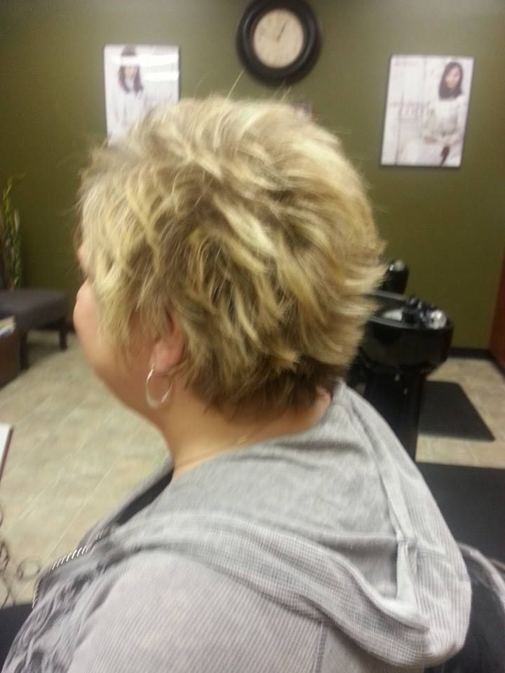 Short, spiky, messy blonde hair. Aveda color.