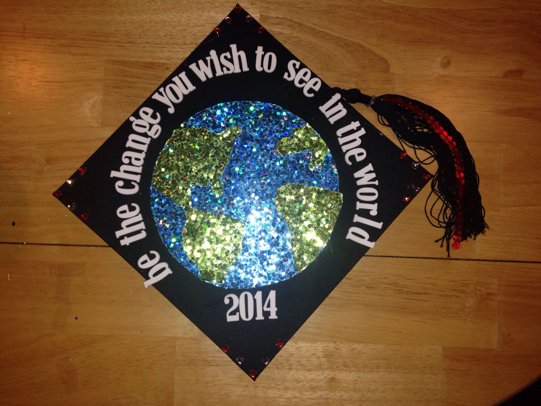 """""""Be the change you wish to see in the world"""" 2014; my graduation cap!!!"""