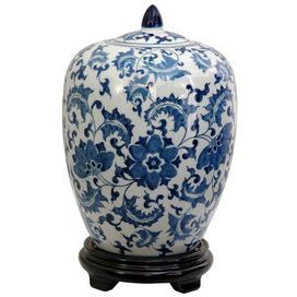 """Blue and white Chinese porcelain jar on a stand.         Product: Jar  Construction Material: Fine Chinese porcelain   Color: White and blue       Features: Melon shape          Dimensions: Opening: 2.75"""" Diameter Overall: 11"""" H x 8"""" Diameter"""