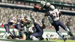 Diving over the defense towards the goal line in Madden NFL 13