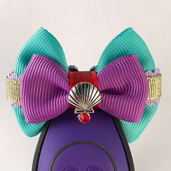 Perfect accesory for any of your Walt Disney World magic bands.  Magic Band bow is approx. 2 inches long, and 1.5 inches tall. It is attached to an elastic band to ensure it stays exactly where you want it on your magic band 1.0 or magic band 2.0. Please note that the MAGIC BAND IS NOT INCLUDED. You are purchasing the bow only. Please message me with any questions.