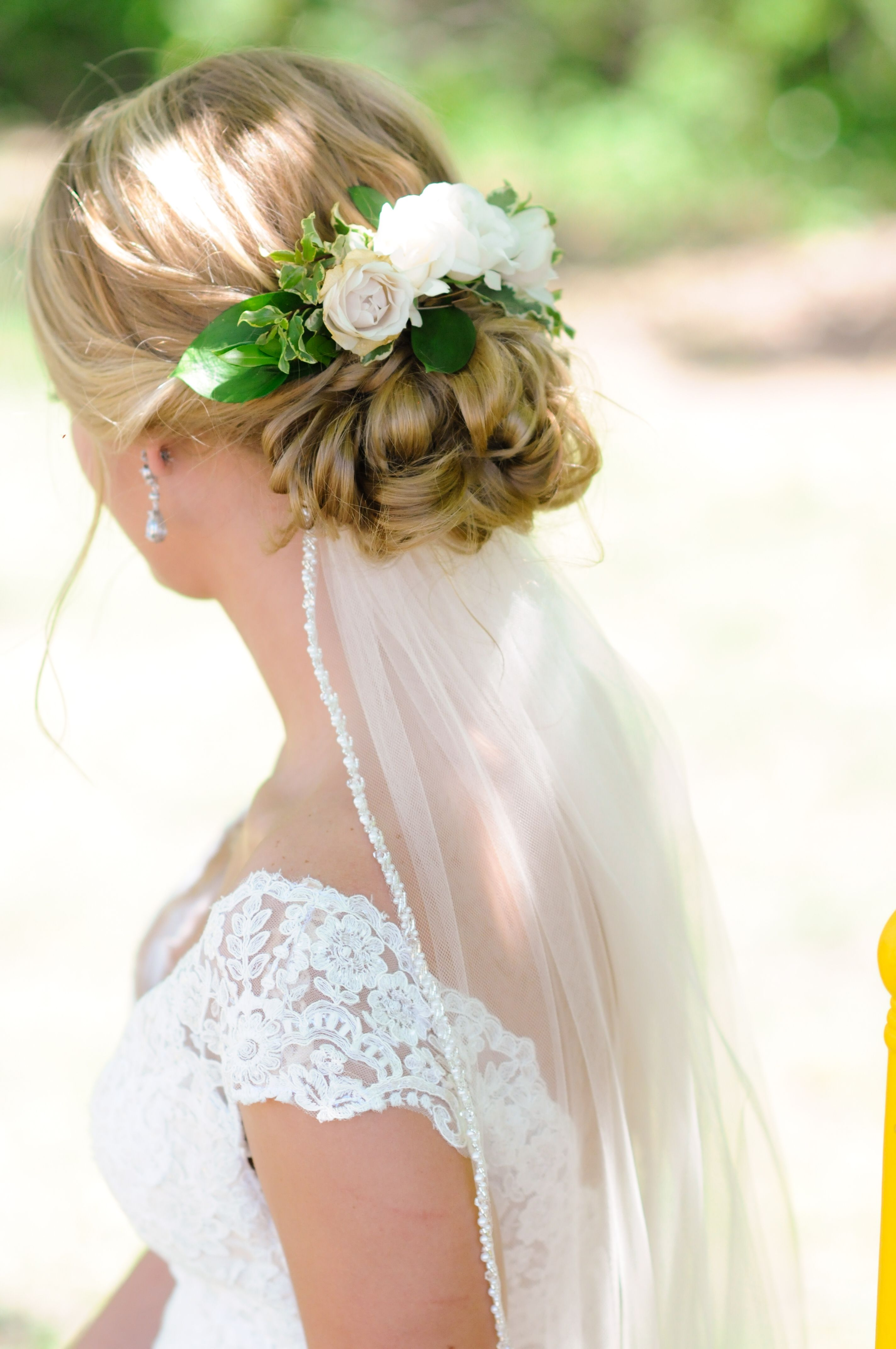 Wedding updo with flowers. Love how my veil went under so that it ...