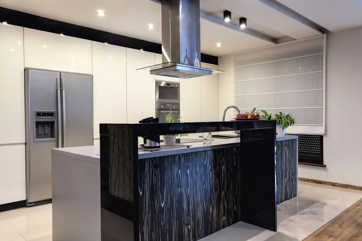 Ultra Modern White And Black Kitchen With Stainless Steel Appliances Luxury Kitchen Design Luxury Kitchen Modern Modern Kitchen Design