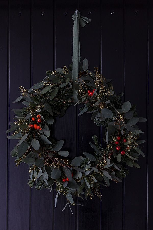 Photo of Eucalyptus wreath homemade with Nobilis fir and rose hips