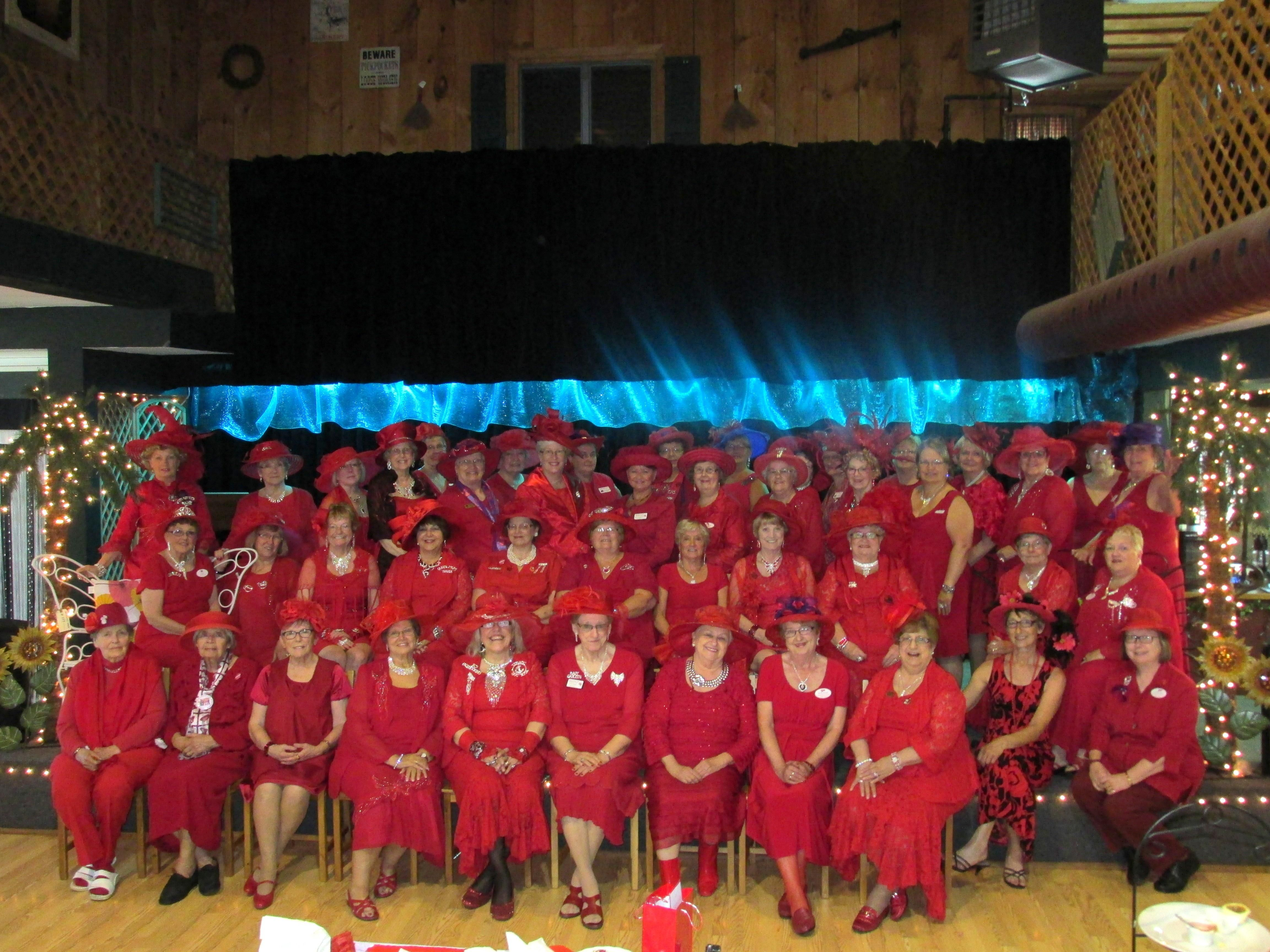 48 Red Hat Supporting Members joined together for a 5th Dress in Red Tea