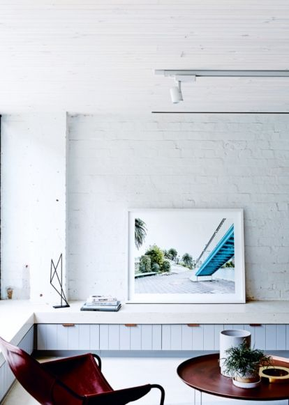 "House tour: an 1880s factory in Melbourne becomes a home for two young professionals: It is the work of Architects EAT, a smallish Melbourne practice with a name eminently suited to carving up a corner of a chocolate factory. ""It's the birthplace of Freddo Frog,"" says the firm's principal, Albert Mo, of the MacRobertson's confectionery works that first made the amphibious-shaped chocolate treat back in 1930."