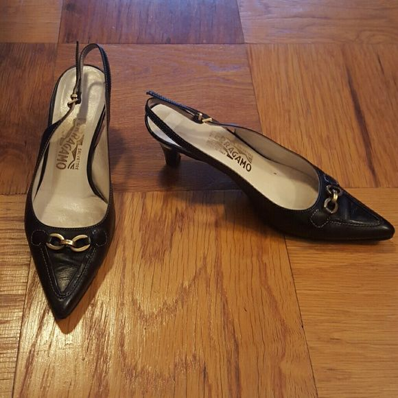 Black Salvatore Ferragamo Sling-Back High Heels A lovely pair of black sling-back high heels from Salvatore Ferragamo. These women's designer shoes feature kitten heels (2 inches in height) and a pointed toe. Made in Florence, Italy. Size 7B (medium width). Still in its original box. Ferragamo Shoes Heels