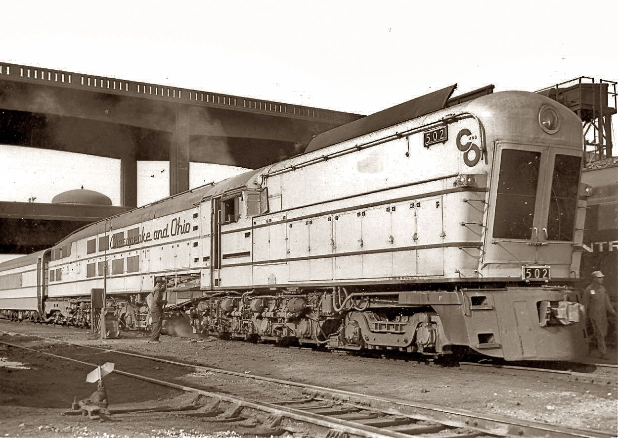 Shorpy Historic Picture Archive ::Chesapeake & Ohio M-1 steam turbine 502 at Cincinnati on July 2, 1949. These coal-fired turbine locomotives were complete failures in passenger service despite their impressive size and complexity. Built in 1947 by Baldwin Locomotive for exorbitant prices, all three were retired by 1950. Color of this engine, in case you're wondering, was yellow-orange up top with gray beneath, with dark blue lettering and trim.