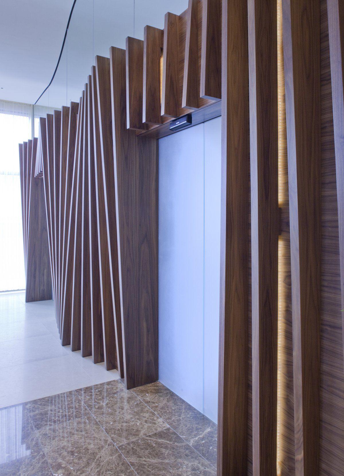 Elevator lobby id cool facades pinterest elevator for Wood slat wall design