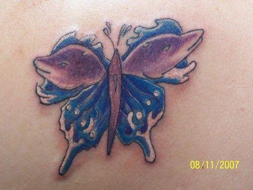 cbc0b59d9 dolphin Tattoos | cool-magic-dolphin-butterfly-tattoo | BodyArtMaster.com