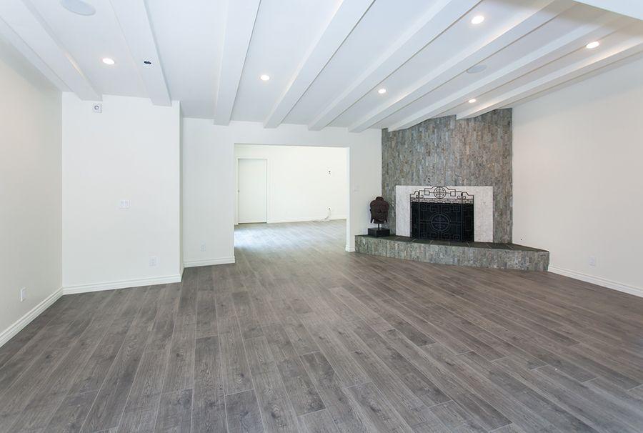 Gray Wood Floor With Huge Fire Place Flooring Grey Wood Floors Design