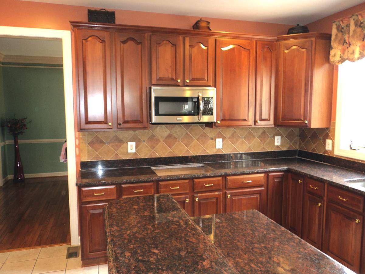 Granite? Black Granite?   Tan kitchen, Tan kitchen ... on Backsplash For Black Granite Countertops And Brown Cabinets  id=94547