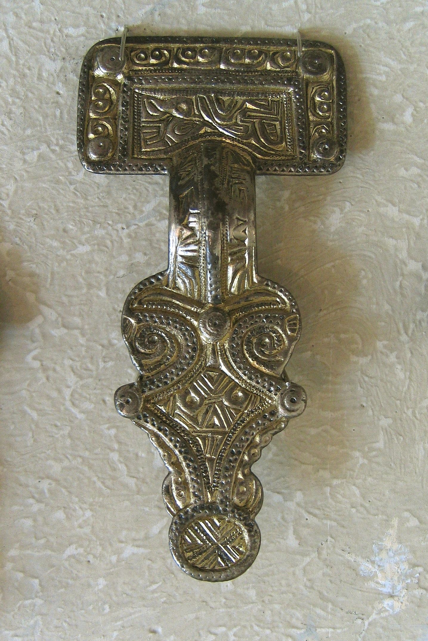 The so-called large Rune Fibula of Nordendorf I. Found in 1843 in an Alemannic grave field of the early 7th century A.D. near Nordendorf, Bavaria, Germany. The fibula bears a runic inscription on the back side of its head plate: (first line) logaþore wodan wigiþonar (second line) awa (l)eubwini. Photographed at the Römisches Museum, Augsburg, Germany.