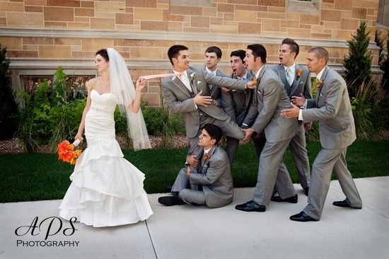 Love the guy wrapped around the groom's leg! Would be cute to have the ring bearer do that too! is part of Funny wedding photos -