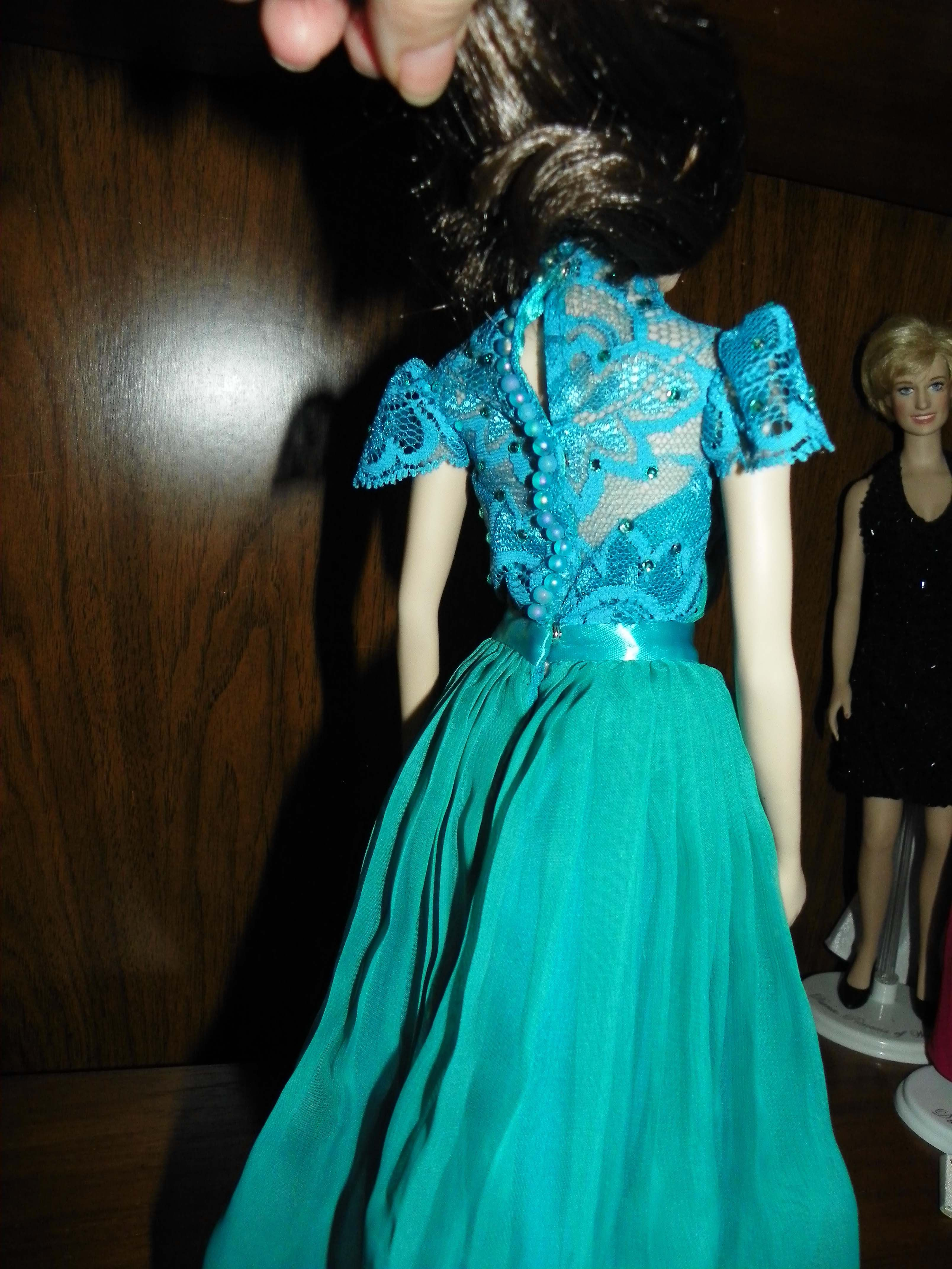 Back view of Jenny Packham teal chiffon gown. Replica by