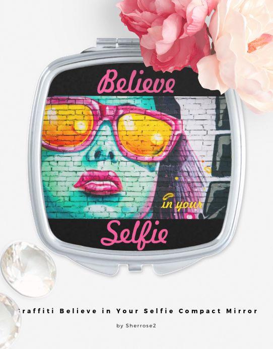 """The Graffiti Believe in Your Selfie Compact Mirror is a great reminder to have confidence in yourself--believe in yourself. The design features a graffiti painting (on a brick wall) of a woman wearing fuchsia sunglasses. Her skin is done in shades of turquoise. The text reads, """"Believe in your Selfie"""" and can be customized as desired. Also makes a great gift for anyone who needs to be reminded to believe in themselves! Be sure to check out the matching shirt and scarf!"""