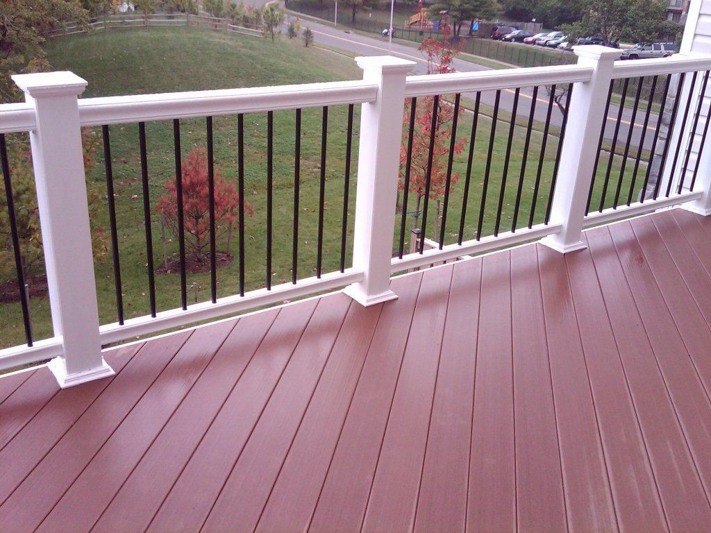Composite decking on a 45 degree angle w white composite for Composite deck railing