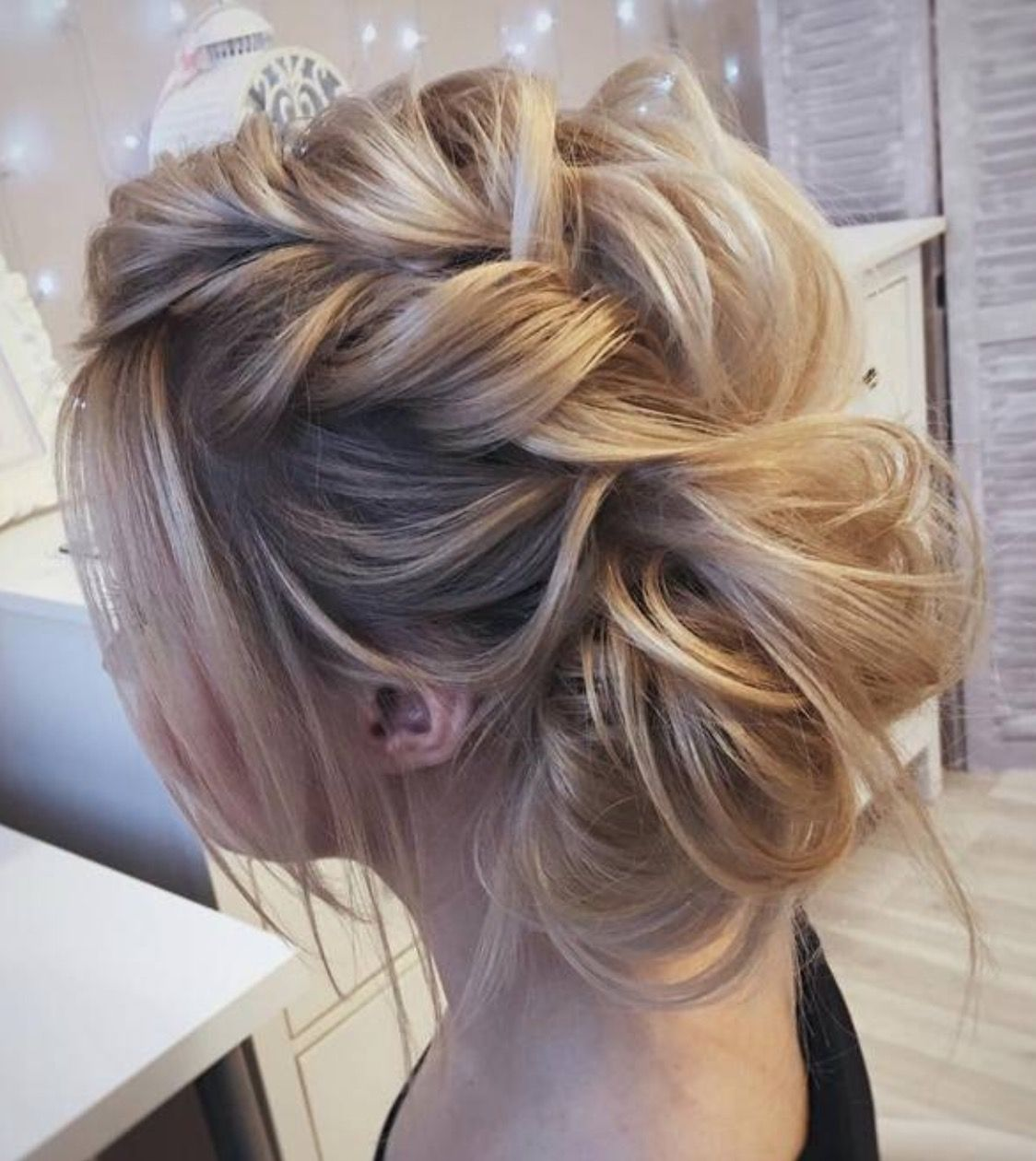 Very Loose Fishtail Braid Pulled Apart Into A Bun With Messy Wispy Pieces Around Medium Length Hair Styles Medium Hair Styles Wedding Hairstyles For Long Hair