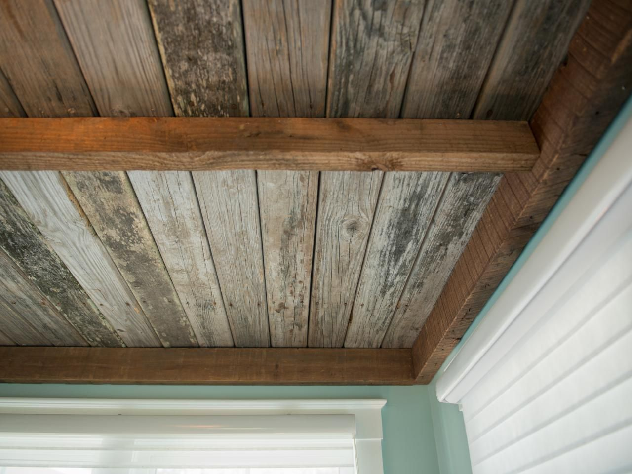 The ceiling is clad in distressed wood from the old dock