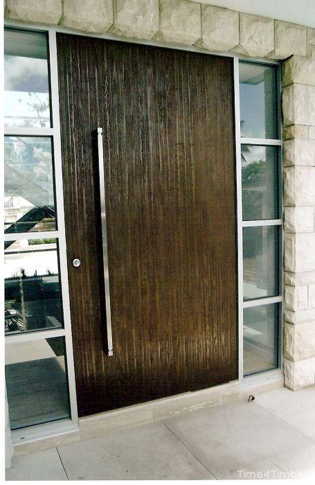Dark Stained Timber Door With Long Steel Handle