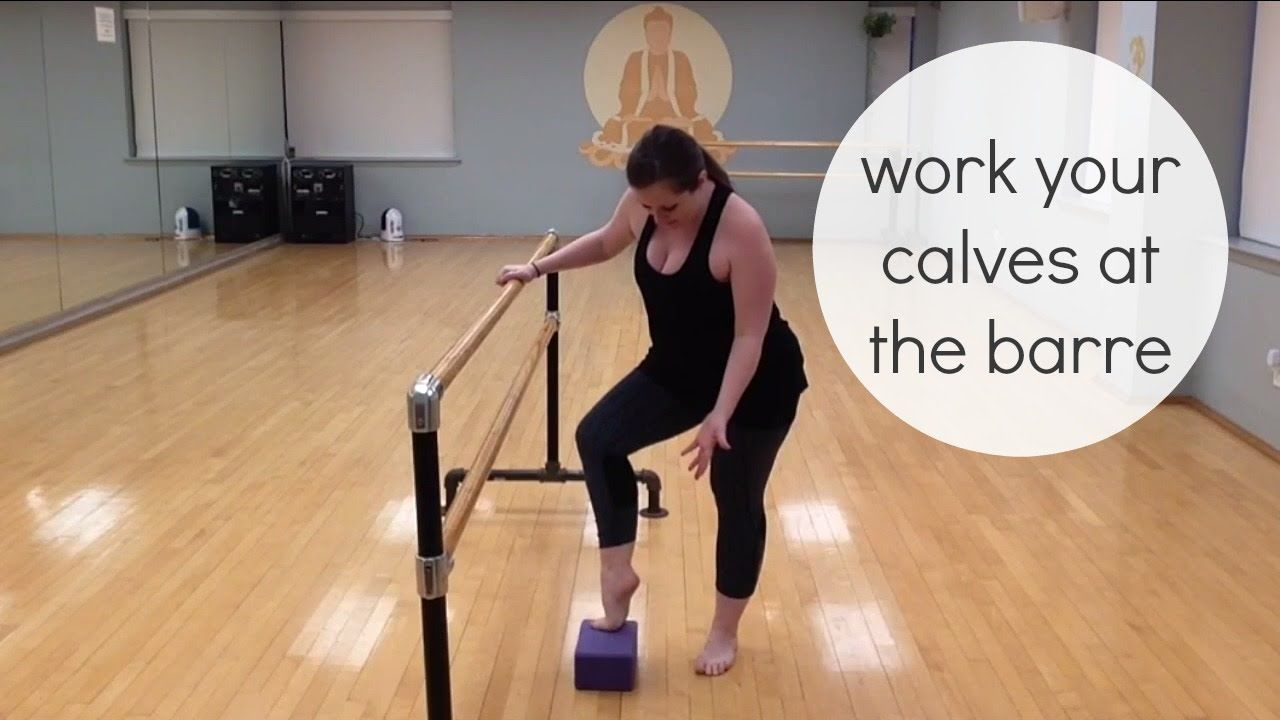 Work your calves at the barre with a yoga block Barre