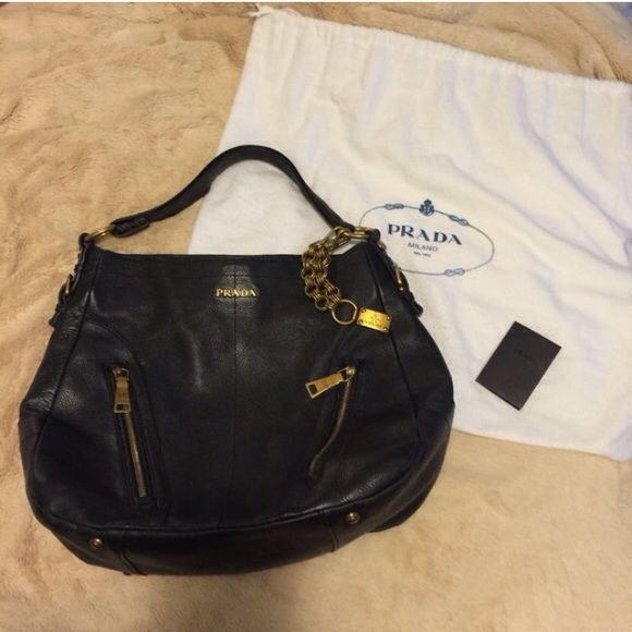 Prada black leather bag in EUC!  Retail $1300! Authentic Prada black bag in good used condition! This bag has two front zippers pockets and one internal zipper +2 back pockets. The internal zipper is broken but could easily be fixed by any shoe repair. Pen marks inside. This bag has been heavily used and has slight marks from use on leather but nothing serious! A good leather cleaner should make this bag like new! Zippers & metal all say Prada! A great all-around every day high quality bag…