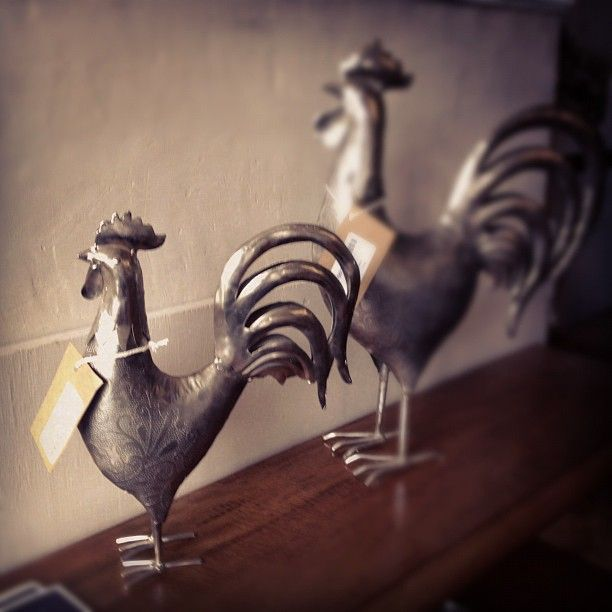 Engraved Roosters at Trading Boundaries