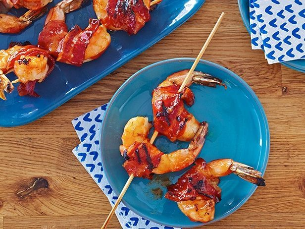 Crisp bacon-wrapped shrimp get brushed with a tangy glaze made from honey, smoked paprika and Sriracha.