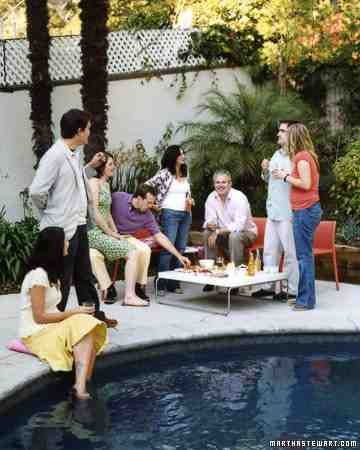 Poolside Party - Set up a low table and colorful plastic chairs by the pool so guests can enjoy small bites and cocktails by the water.