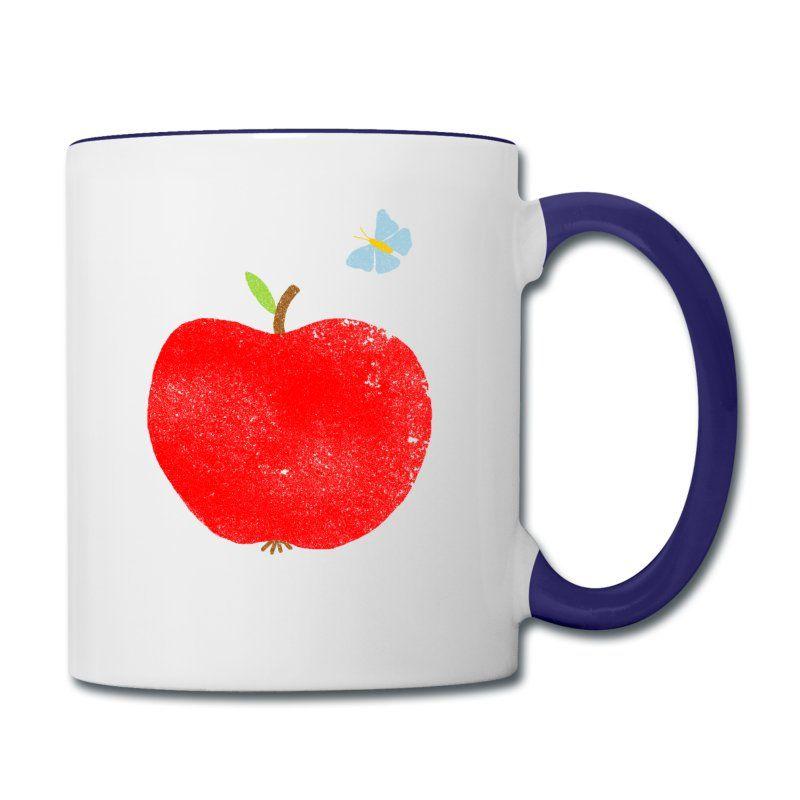 roter Apfel mit blauem Schmetterling.