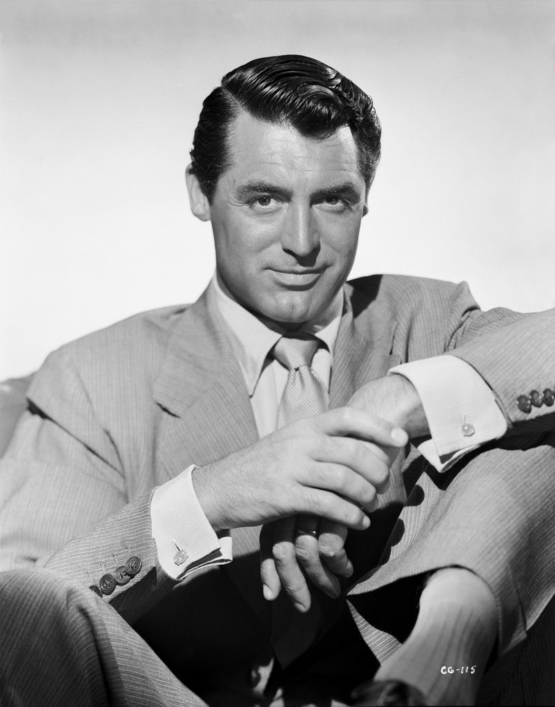 Cary Grant portrait in suit and tie holding hand Premium Art Print