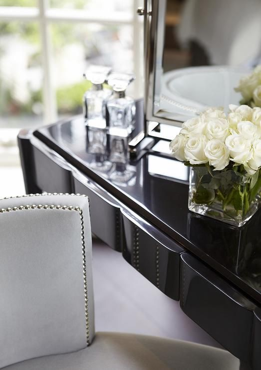 Chic Dressing Room Boasts Glossy Black Lacquer Make Up Vanity Topped With A  Pivot Mirror Alongside