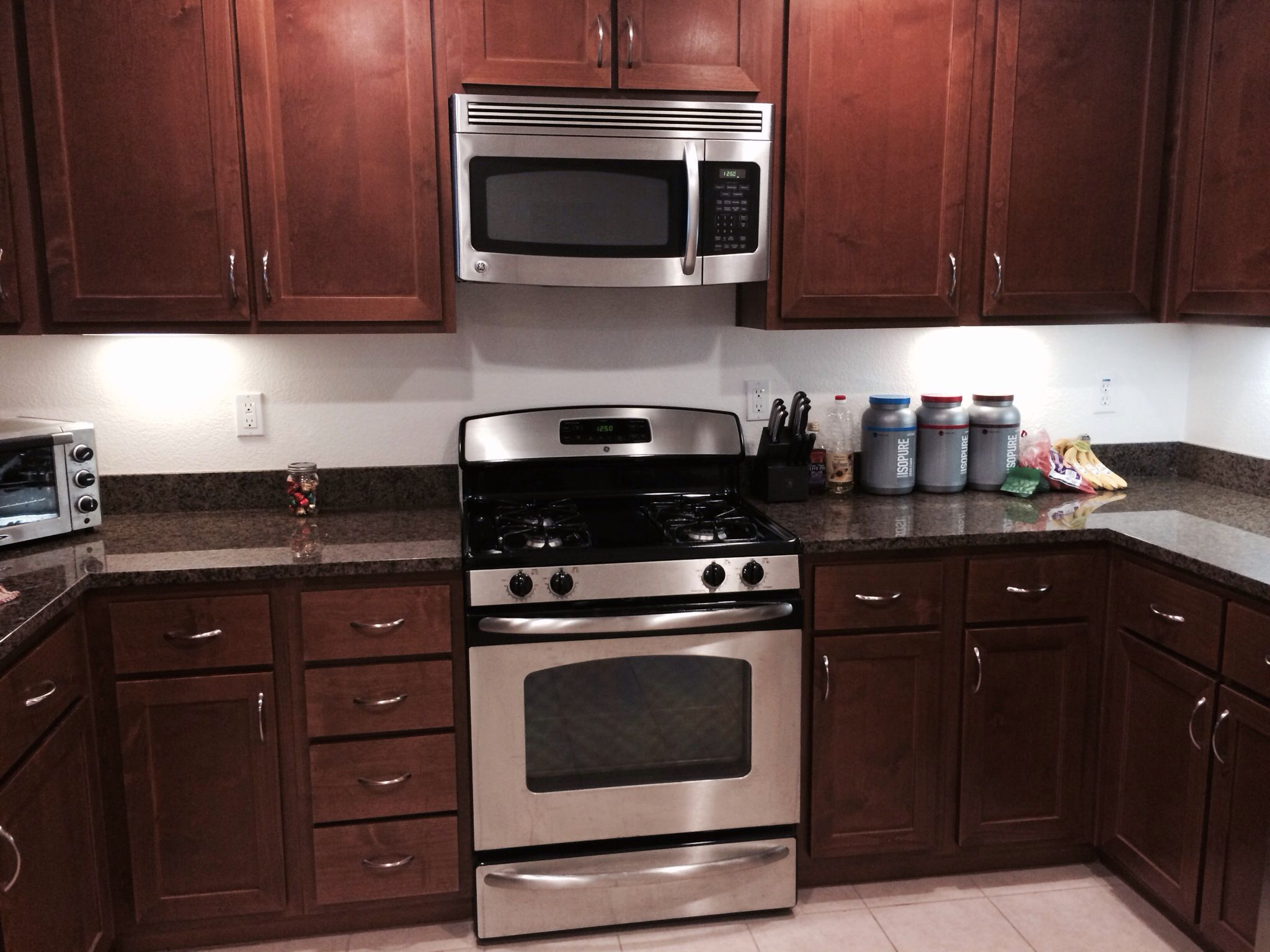 mahogany kitchen cabinets two seat table in the with black and tan