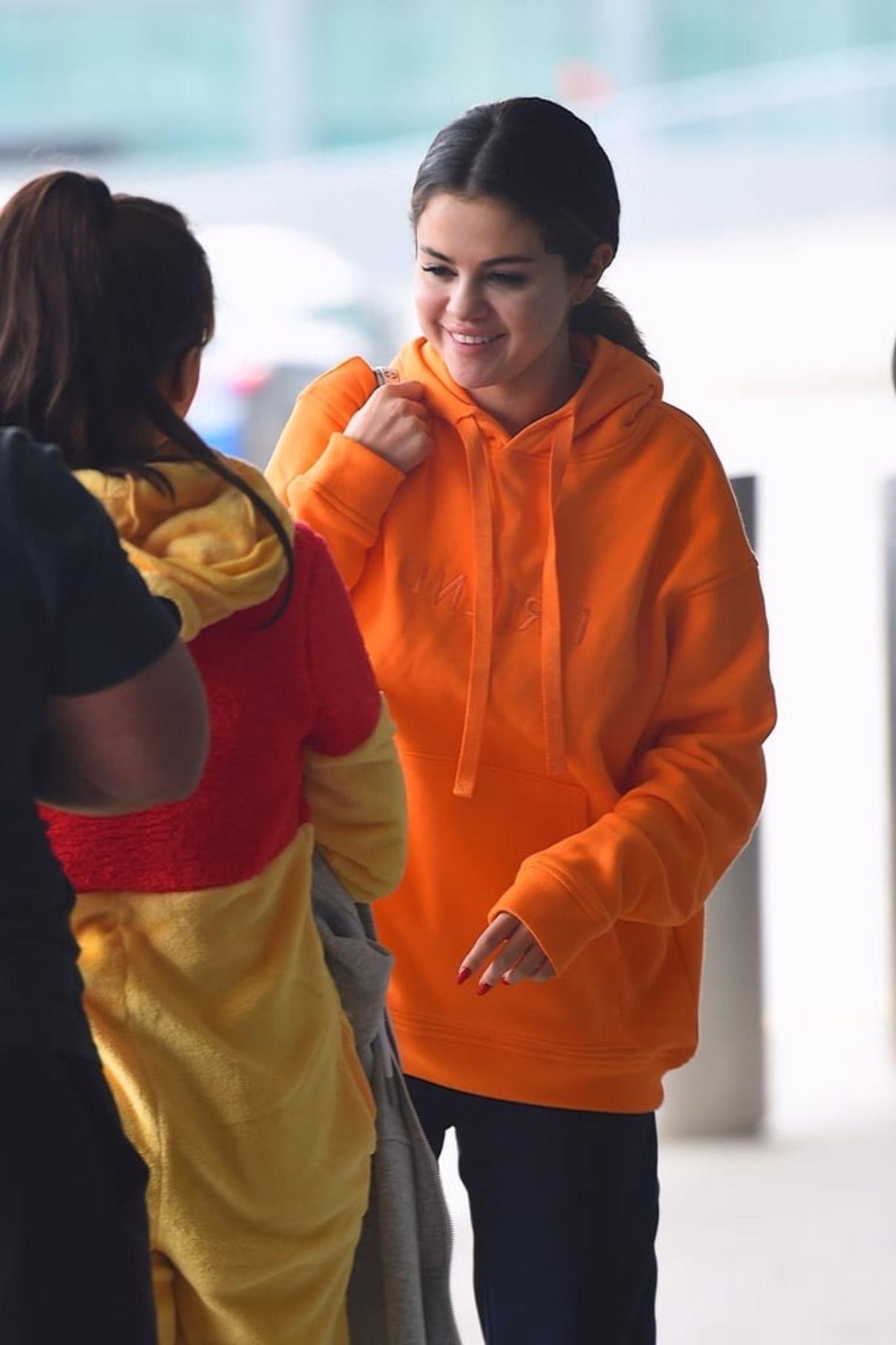 Predownload: Selena Gomez In Friend Hoodie And Syf Track Pant Selena Gomez Style Sweatsuit Selena Gomez Airport [ 1815 x 1210 Pixel ]