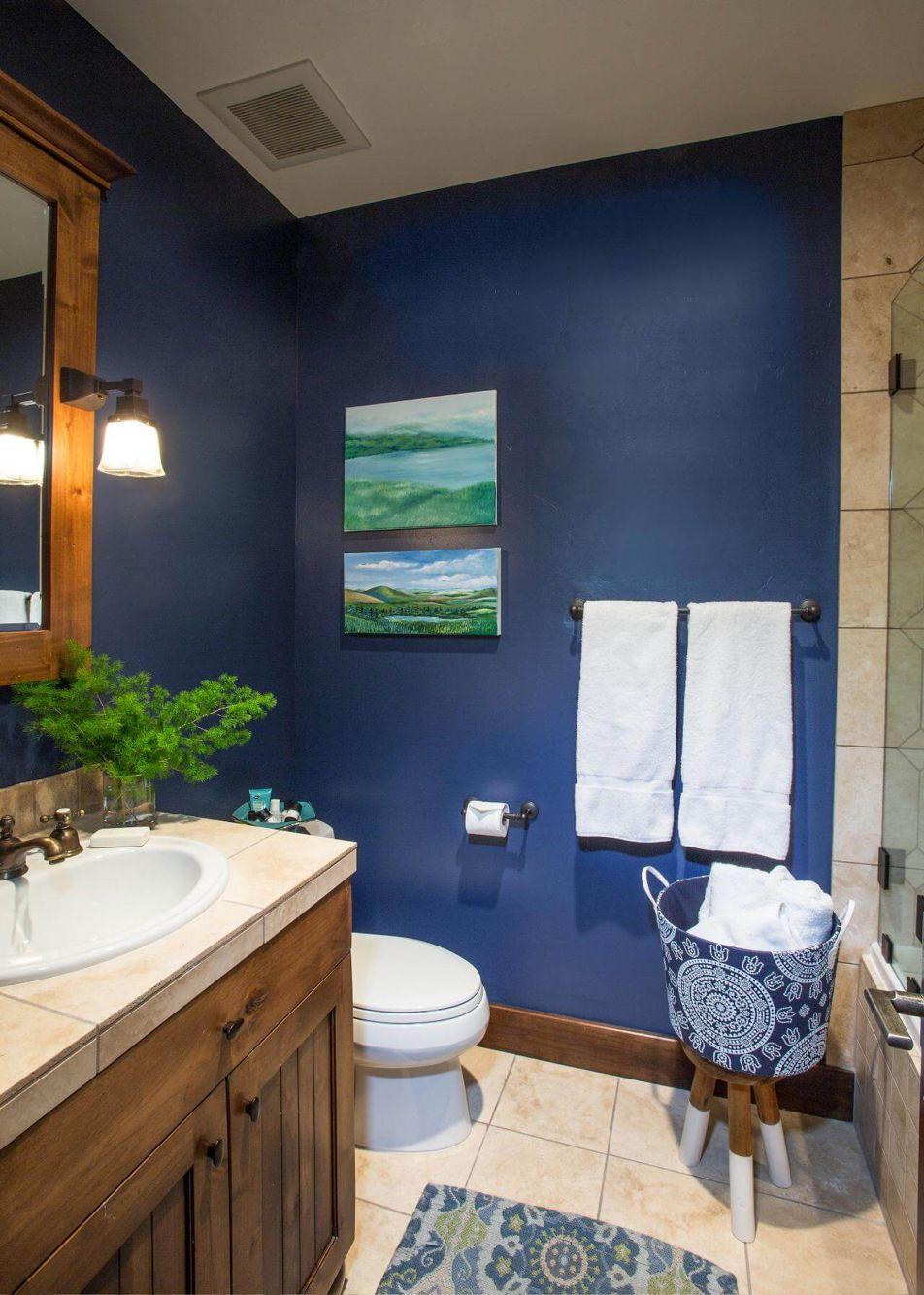 Navy Blue Walls Oak Cabinet Oiled Bronzed Fixtures Tile Floors