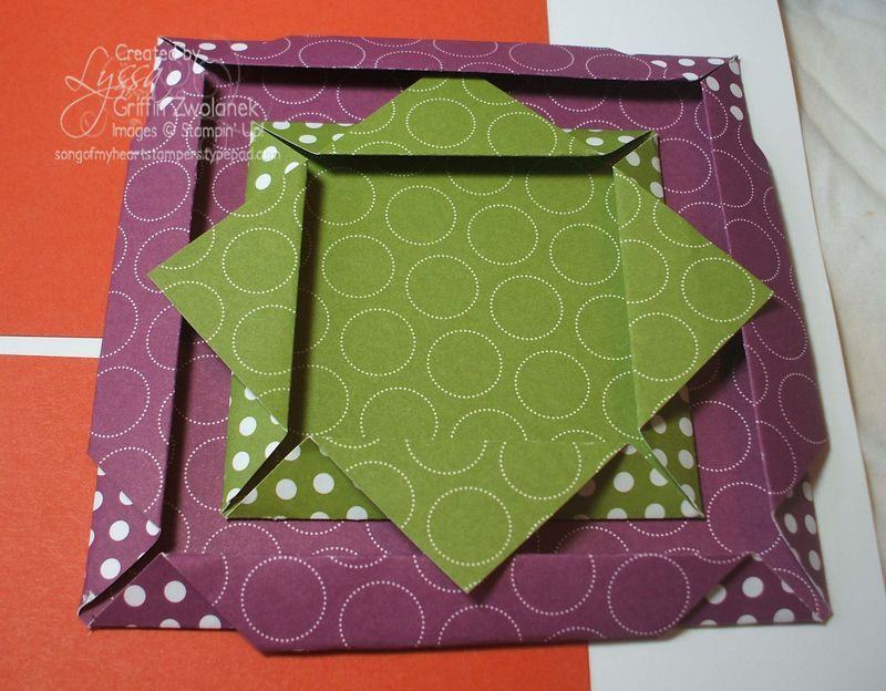 a fun frame fold on this page that is easy and quick to do. For the interior frame, start with a 4x4 square and fold all four corners in towards the middle. Then fold the corners back on themselves. For the bottom frame, start with a 6x6 square and do the same two steps, but then fold the protruding corners around to the back of the frame and secure with a bit of SNAIL adhesive.