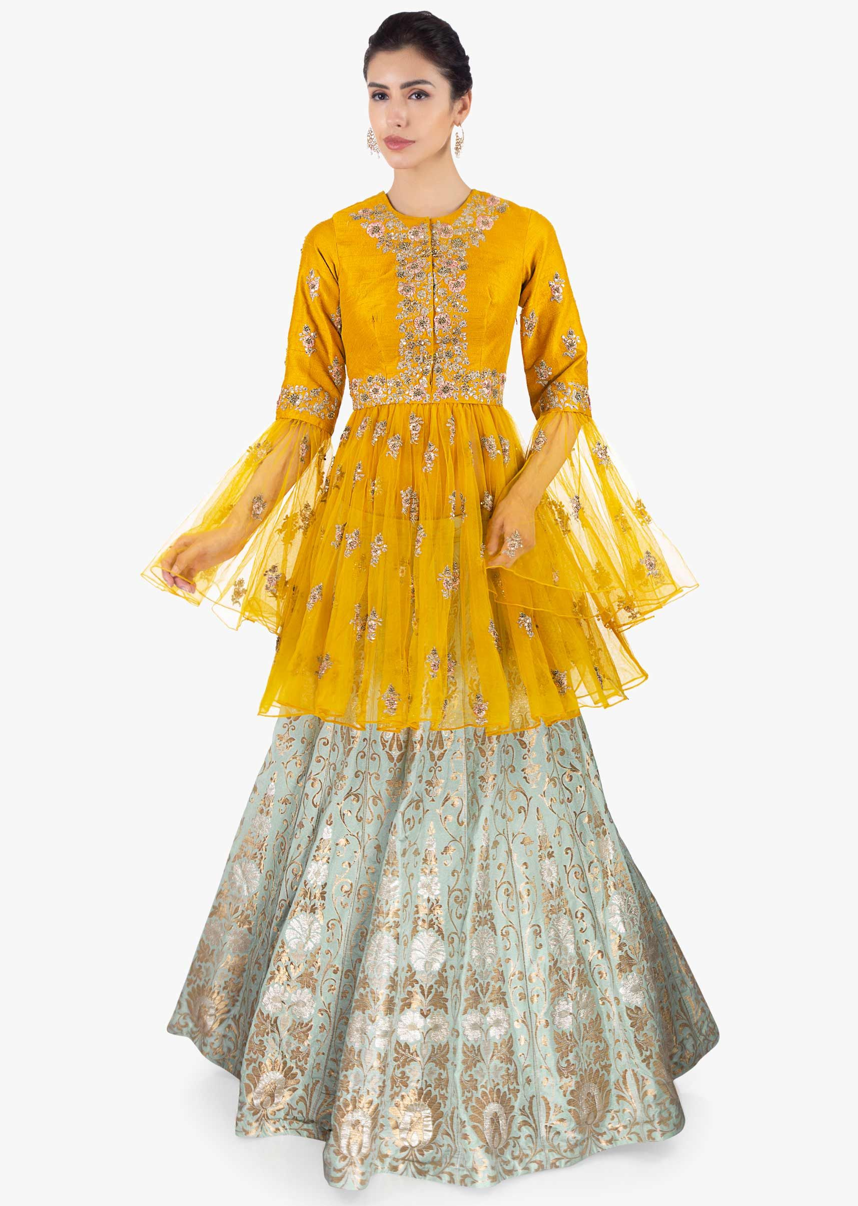 595f8a82170a0 Mint green brocade lehenga paired with mustard thigh length long top only  on Kalki