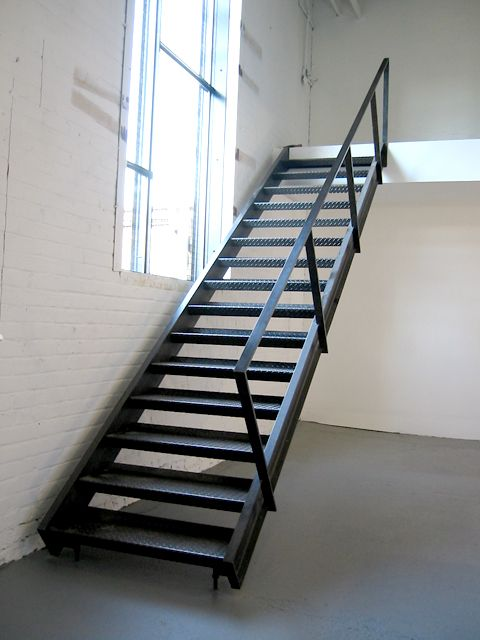 Custom blackened steel staircase with diamond plate treads for Custom staircase design