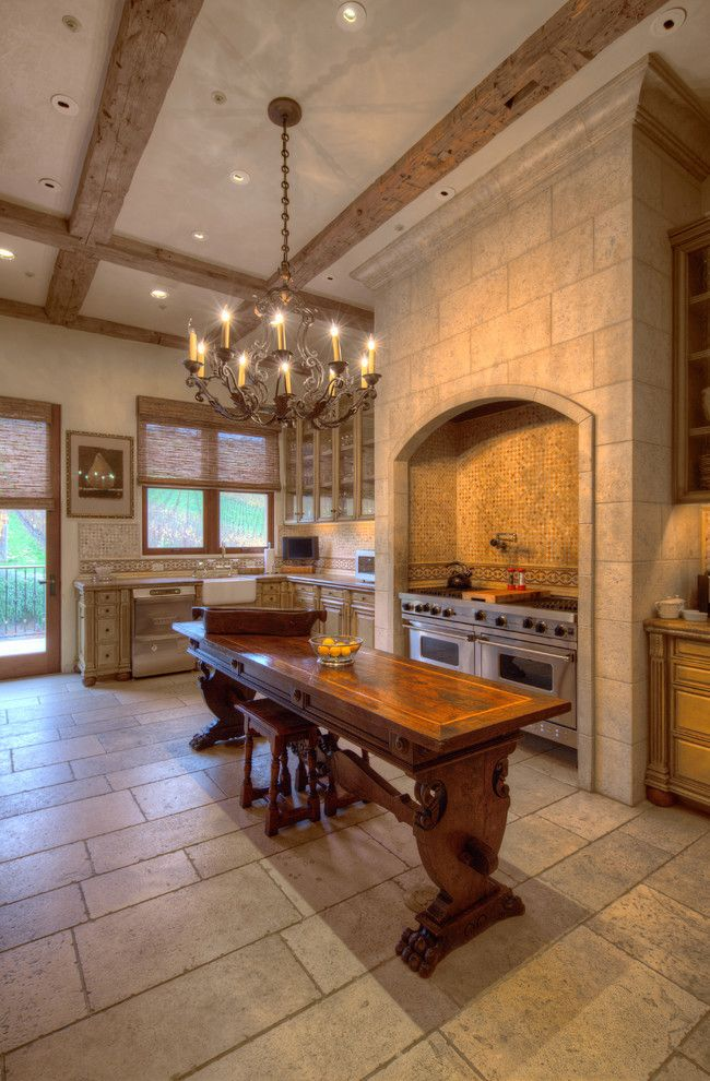 A Medieval Style Kitchen Complete With Stone Interior And Wooden Furniture To The Look