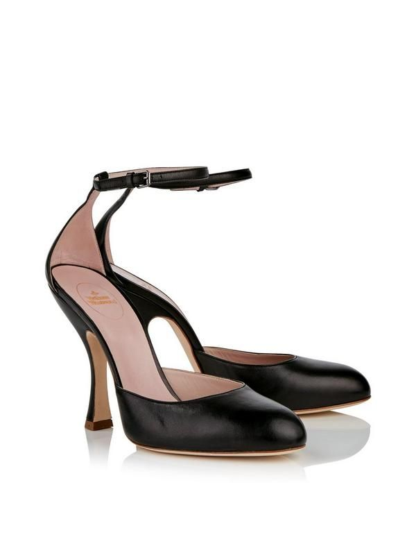 VIVIENNE WESTWOOD Olly Ankle Strap Shoes - Black The 'Olly' shoes from Vivienne Westwood are crafted from sumptuously soft nappa leather and feature an elegantly rounded toe and curved vamp for a chic silhouette. A slender ankle strap and crescent heel finish the seductive shape of these timeless classics. Olly Ankle Strap Shoe by Vivienne WestwoodHeel height: 11.5cmBlackCurved toeAnkle strapCurved heelMaterialNappa leather