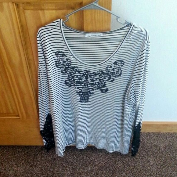 Black/white shirt Rarely worn, lace detail on the sleeve (wrist area) Maurices Tops Blouses