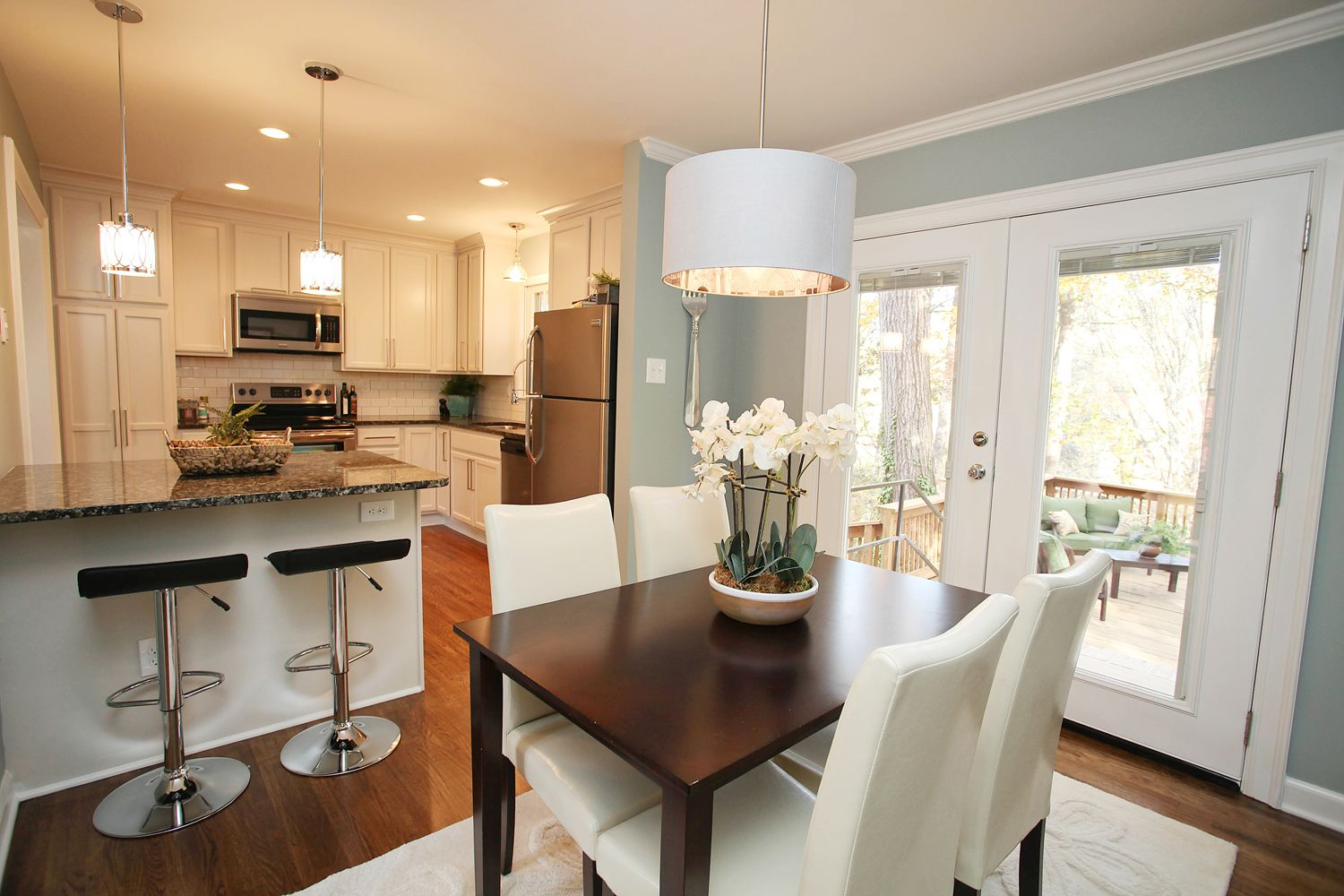 Split Level-opened Kitchen. Pendant Over Table And