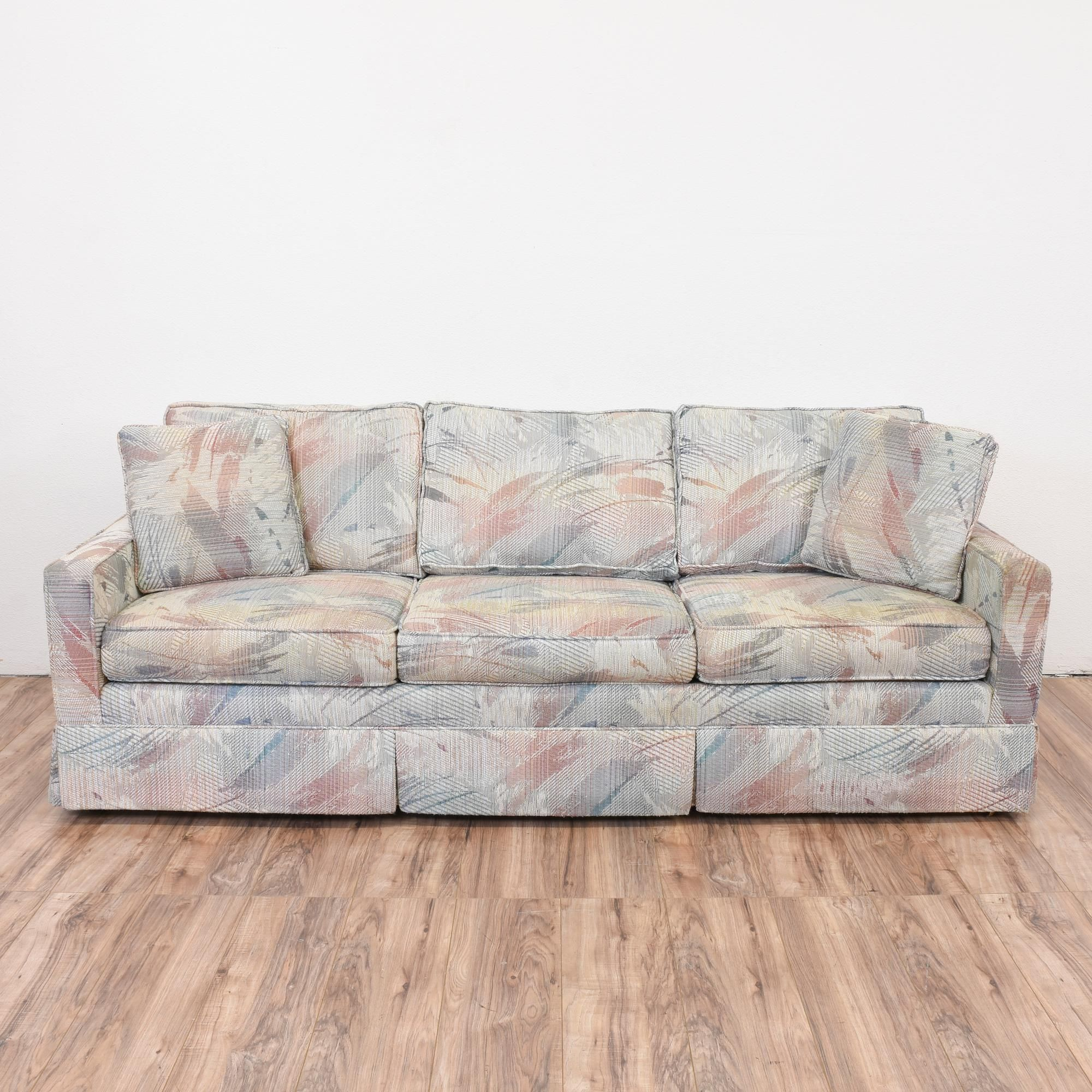 This Retro Sofa Is Upholstered In A Durable Light Gray Fabric With A Pastel  Pink,