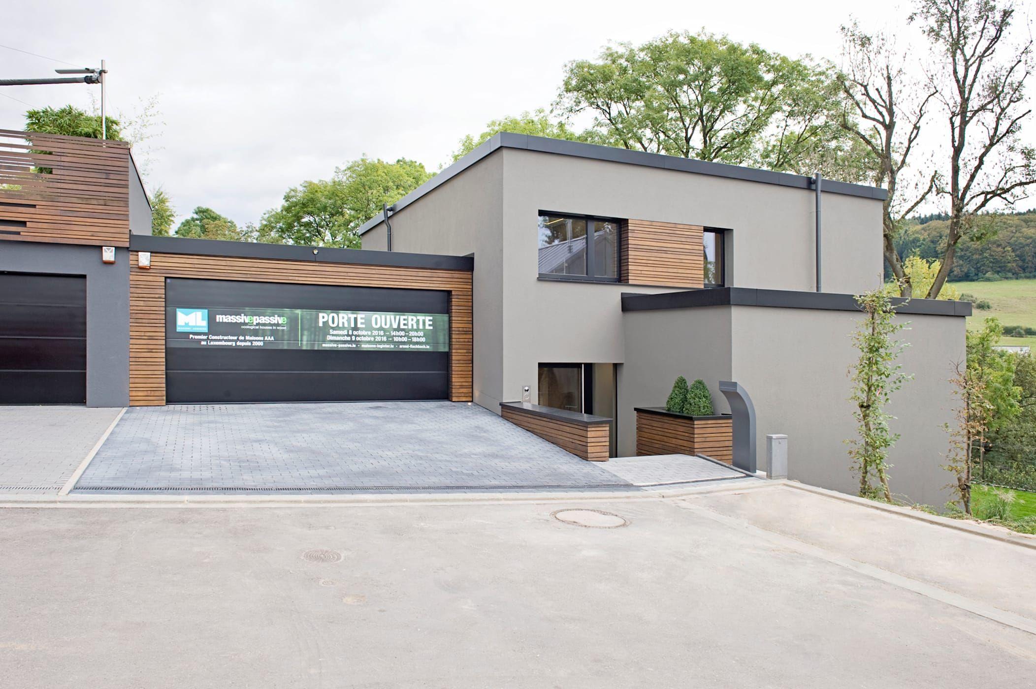 Hybrides und ökologisches einfamilienhaus aus beton und massivholz in mersch (luxemburg) moderne häuser von massive passive modern | homify
